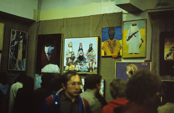 "The 5th General TEII Exhibition ""Facets of Portraiture"", Leningrad, September 1984 more >> Second painting on the left: (E-E) Evgenij Kozlov Noli me tangere, original title Туареги • Tuaregs Tempera, gouache watercolour and collage on canvas, 93 x 106 cm, 1982. The Kozlov & Fobo Collection, Berlin Paintings on the right: two portraits by Vladislav Gutsevich Bottom right: a fragment of Timur Noikov's portrait of Sergei Bugaev from 1984 photo: Alexander Boyko, 1984"